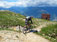 Niall riding across some of the trenches on the 601 trail on Mt Altissimo at Lake Garda